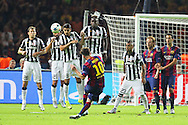 Barcelona Lionel Messi shots at goal with a free kick during the Champions League Final between Juventus FC and FC Barcelona at the Olympiastadion, Berlin, Germany on 6 June 2015. Photo by Phil Duncan.