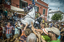 July 25, 2017 - Es Castell, Balearic Islands, Spain - A 'caixer' (horse rider) rears up on his horse surrounded by a cheering crowd during the 2nd 'Jaleo' of the traditional 'Sant Jaume' (Saint James) festival in Es Castell, the town's patron saint fiesta (Credit Image: © Matthias Oesterle via ZUMA Wire)