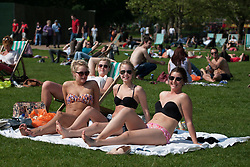© licensed to London News Pictures. London, UK 22/05/2012. Sara Christenson, Hanna Christenson, Emilia Persson and Josephine Mattsson (left to right) enjoying sunshine in Hyde Park today as the sunshine and hot weather comes to London (22/05/12). Photo credit: Tolga Akmen/LNP