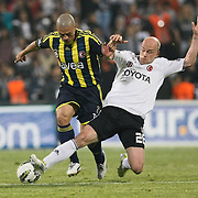 Besiktas's Fabian Ernst (R) and Fenerbahce's Alexsandro de Souza (L) during their Turkish Superleague SuperFinal Derby match Besiktas between Fenerbahce at the Inonu Stadium at Dolmabahce in Istanbul Turkey on Thursday, 03 May 2012. Photo by TURKPIX