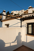 Leanna takes a self portrait of her shadow in the late afternoon on the patio of Hotel Alavera in Ronda, Spain.