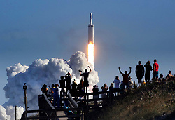 February 6, 2018 - Cape Canaveral, Florida, US - The crowd cheers at Playalinda Beach in the Canaveral National Seashore, just north of the Kennedy Space Center, during the succesful launch of the SpaceX Falcon Heavy rocket. Playalinda is one of closest public viewing spots to see the launch, about 3 miles from the SpaceX launchpad 39A. (Credit Image: © Joe Burbank/TNS via ZUMA Wire)
