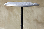 little round marble bistro table top covered with snow