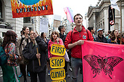 Climate change activist from the Extinction Rebellion group sings songs and block the streets outside the Bank of England in a swarming tactic in the heart of the City of London financial district in protest that the government is not doing enough to avoid catastrophic climate change and to demand the government take radical action to save the planet, on 25th April 2019 in London, England, United Kingdom. Extinction Rebellion is a climate change group started in 2018 and has gained a huge following of people committed to peaceful protests.