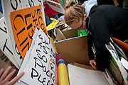 Occupy Boston members choose a sign before they march in Boston, Massachusetts, October 29, 2011.