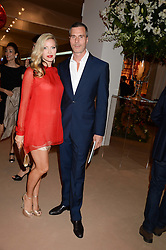TY COMFORT and CAPRICE BOURRET at the Masterpiece Midsummer Party in aid of Marie Curie Cancer Care held at The Royal Hospital Chelsea, London on 2nd July 2013.