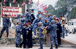 "Kathmandu, 18 February, 2005. Nation's Democracy Day. Police officers gathering after duty at Ratna Park. ""Today we have arrested several people. They were planning pro-democracy rallies, but we didn't give them any chance to demonstrate"", a police officer said. Authorities have, once again, cut off local telephone lines; public transport has also been banned for most of the day."