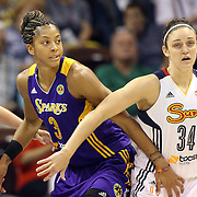 Candace Parker, (left),  Los Angeles Sparks, defended by Kelly Faris, Connecticut Sun, during the Connecticut Sun Vs Los Angeles Sparks WNBA regular season game at Mohegan Sun Arena, Uncasville, Connecticut, USA. 3rd July 2014. Photo Tim Clayton