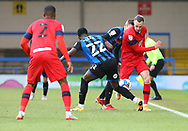 Wigan Athletic forward Will Keane(10) looks to pass the ball to team mate Wigan Athletic defender Tendayi Darikwa (2) but is tackled by Kwadwo Baah of Rochdale (22) during the EFL Sky Bet League 1 match between Rochdale and Wigan Athletic at the Crown Oil Arena, Rochdale, England on 16 January 2021.