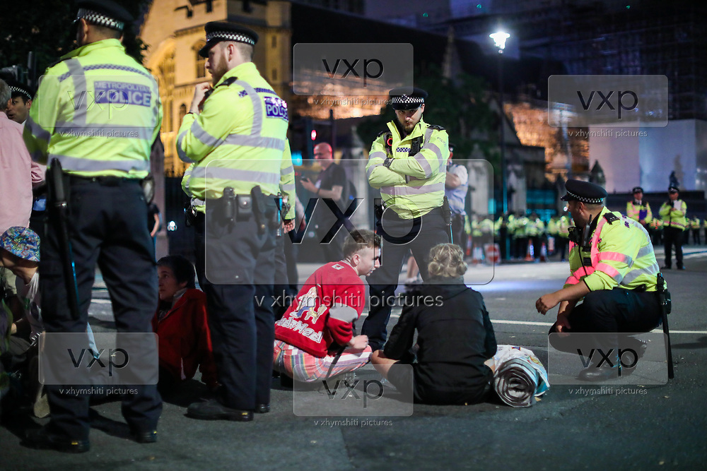 London MET Police served section 14 of British Public Order to the last remaining few anti-Brexit protesters, dispersed and arrested two of them in a late before mid-night in front of the Houses of Parliament in central London, Wednesday, Aug. 28, 2019. <br /> British Prime Minister Boris Johnson maneuvered on Wednesday to give his political opponents even less time to block a no-deal Brexit before the Oct. 31 withdrawal deadline, winning Queen Elizabeth II's approval to suspend Parliament. (Photo/Vudi Xhymshiti)