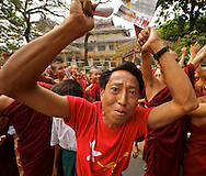 A man cannot contain is jubilation for the historical moment. Mandalay, Myanmar. 2012