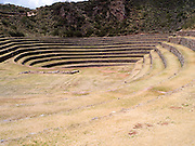View of the Moray Terraces, an area where Inca cultures experimented with agriculture, near Cusco, Peru.