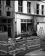 Car Bomb Damage in Dublin (E10)..1972.02.12.1972..12.02.1972..2nd December 1972..On the morning of 2nd December '72 two car bombs exploded in Dublin City. At Sackville Place two busmen were killed as they waited in their car to resume work. The busmen were named as George Bradshaw (30) and Thomas Duffy (23). The bomb was thought to be planted by a Northern Ireland subversive group who hoped to influence legislation going through Dail Eireann in relation to the I.R.A...Image of the car,thought to be the bomb vehicle, as it lies in a crumpled heap in Sackville Place.