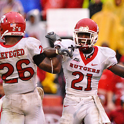 Sep 26, 2009; College Park, MD, USA; Rutgers cornerback Devin Mccourty (21) and cornerback Joe Lefeged (26) celebrate forcing a turnover on downs during the second half of Rutgers' 34-13 victory over Maryland in NCAA college football at Byrd Stadium.
