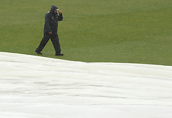 The Ageas Bowl ground staff cover the pitch during heavy rain on day two of the match between Hampshire and Somerset - Photo mandatory by-line: Robbie Stephenson/JMP - Mobile: 07966 386802 - 22/06/2015 - SPORT - Cricket - Southampton - The Ageas Bowl - Hampshire v Somerset - County Championship Division One