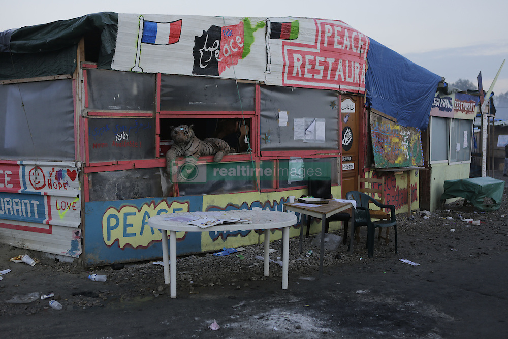 October 25, 2016 - Calais, Nord-Pas-de-Calais-Picardie, France - The Peace restaurant has been abandoned. A little less than 2000 refugees are expected to be disbursed from the Jungle to different areas in France on the 2nd day of the eviction of the Jungle in Calais. It is also expected that the demolition of the camp will start. (Credit Image: © Michael Debets/Pacific Press via ZUMA Wire)