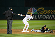 Oakland Athletics right fielder Mark Canha (20) reacts to beating a throw at second base against the Miami Marlins at Oakland Coliseum in Oakland, Calif., on May 23, 2017. (Stan Olszewski/Special to S.F. Examiner)