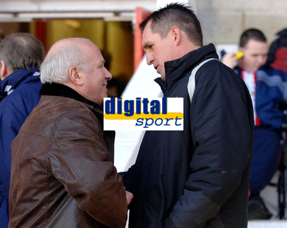Photo: Daniel Hambury.<br />Brentford v Sunderland. The FA Cup. 28/01/2006.<br />Brentford's non-executive chairman Greg Dyke (L) and manager Martin Allen shake hands before kick off.