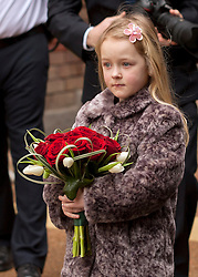© Licensed to London News Pictures. 14/02/2012. Liverpool, UK. Aimee Haswell aged 7 holds a heart shaped posy of Roses for The Duchess of Cambridge ahead of her visit to Alder Hey Hospital. Photo credit : Ashley Hugo/LNP