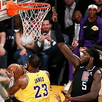 LOS ANGELES, CA - MAR 04: LeBron James (23) of the Los Angeles Lakers goes for the reverse layup against Montrezl Harrell (5) of the LA Clippers during a game on March 04, 2019 at the Staples Center in Los Angeles, California.