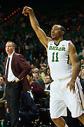 WACO, TX - DECEMBER 9: Lester Medford #11 of the Baylor Bears reacts after shooting a three-pointer against the Texas A&M Aggies on December 9, 2014 at the Ferrell Center in Waco, Texas.  (Photo by Cooper Neill/Getty Images) *** Local Caption *** Lester Medford