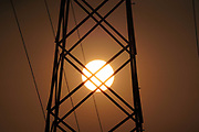 The sun sets over skies darkened by wildfires, Tuesday, Sept 15, 2020, in Monterey Park, Calif.