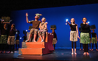 """Mufasa (Josh Testa) and Simba (Jesse Powers) sit under the stars at Pride Rock during dress rehearsal for Gilford Middle School's production of """"The Lion King"""" on Monday afternoon.  (Karen Bobotas/for the Laconia Daily Sun)"""