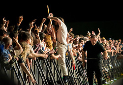 © Licensed to London News Pictures; 03/09/2021; Bristol, UK. Guitarist LEE KIERNAN with IDLES goes crowd surfing at the main stage at the Idles on the Downs, where the band Idles will be headlining their Bristol homecoming show. Taking place across three festival-sized stages, the event is a one day festival on the same site on Bristol Downs as Love Saves the Day taking place on Saturday and Sunday. Event organisers Team Love and Simple Things, alongside IDLES, are making available 2,000 complimentary tickets to local NHS workers to say 'thank you' for their amazing work on the frontline of the Covid-19 pandemic.  The festival will also be supporting a range of local community organisations and charities Photo credit: Simon Chapman/LNP.