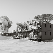 The Dark Sector Laboratory, which houses the South Pole Telescope (left), and the BICEP3 telescope, both are imaging the CMB, cosmic microwave background.
