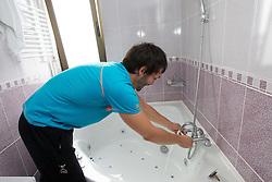 David Spiler making a bath during visit in the rooms of Slovenia Men Handball team during 5th day of 10th EHF European Handball Championship Serbia 2012, on January 19, 2012 in Hotel Srbija, Vrsac, Serbia.  (Photo By Vid Ponikvar / Sportida.com)