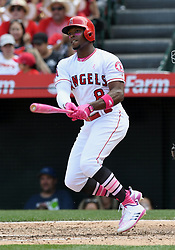 May 13, 2018 - Anaheim, CA, U.S. - ANAHEIM, CA - MAY 13: Los Angeles Angels of Anaheim outfielder Juistin Upton (8) drives in a run in the fifth inning of a game against the Minnesota Twins played on May 13, 2018 at Angel Stadium of Anaheim in Anaheim, CA. (Photo by John Cordes/Icon Sportswire) (Credit Image: © John Cordes/Icon SMI via ZUMA Press)