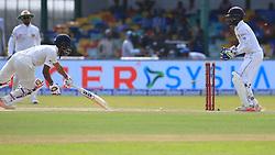 August 4, 2017 - Colombo, Sri Lanka - Indian batsman Wriddhiman Saha is stumped out by Sri Lankan wicket keeper Niroshan Dickwella (R) during the 2nd Day's play in the 2nd Test match between Sri Lanka and India at the SSC international cricket stadium at the capital city of Colombo, Sri Lanka on Friday 04 August 2017. (Credit Image: © Tharaka Basnayaka/NurPhoto via ZUMA Press)