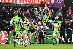 Ospreys' Sam Davies and Northampton Saints' Nic Groom contest the high ball<br /> <br /> Photographer Craig Thomas/Replay Images<br /> <br /> EPCR Champions Cup Round 4 - Ospreys v Northampton Saints - Sunday 17th December 2017 - Parc y Scarlets - Llanelli<br /> <br /> World Copyright © 2017 Replay Images. All rights reserved. info@replayimages.co.uk - www.replayimages.co.uk