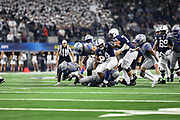 Penn State Nittany Lions running back Journey Brown (4) runs to the outside as defensive back Sanchez Blake Jr. (41) and cornerback Chris Claybrooks try to make the tackle during the game of the NCAA Cotton Bowl Classic football game, Saturday, Dec. 28, 2019, in Arlington, Texas. Penn State defeated Memphis 53-39. (Mario Terrana/Image of Sport)