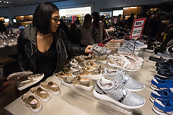 © Licensed to London News Pictures. 26/12/2016. Customers in the ladies shoe department of Selfridges store in Oxford Street for the start of the stores Boxing Day sales. London, UK. Photo credit: Ray Tang/LNP