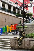 The Statue of Milio The Great Gossiper, Knyaz Aleksander street, Plovdiv, Bulgaria