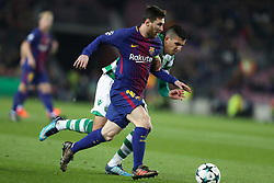 December 5, 2017 - Barcelona, Catalonia, Spain - LIONEL MESSI of FC Barcelona duels for the ball with RODRIGO BATTAGLIA of Sporting CP during the UEFA Champions League, Group D football match between FC Barcelona and Sporting CP on December 5, 2017 at Camp Nou stadium in Barcelona, Spain. (Credit Image: © Manuel Blondeau via ZUMA Wire)