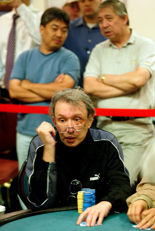 September 1, 2003: Vegas legend Bob Stupak draws a crowd to his table to watch him play at the World Poker Tour event at the Bicycle Club in Los Angeles. The yellow chips represent $1000 each and the blue are $500 chips.