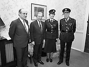 First Female Garda Superintendent.   (R97)..1989..21.02.1989..02.21.1989..21st February 1989..Ms Phyllis Nolan the first female Garda to reach the rank of Superintendent paid a courtesy call to An Taoiseach, Charles Haughey TD, at his office today. She was accompanied by the Garda Commissioner, Mr Eugene Crowley...Image shows (L-R) Mr Gerry Collins TD, Minister for Justice, An Taoiseach Mr Charles Haughey TD, Garda, Supt Phyllis Nolan and Garda Commissioner , Eugene Crowley at the office of An Taoiseach in Government Buildings.