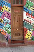 Colorful steet art adorns the walls surrounding the entrance to a hostel in Cerro Alegre, Valparaiso.