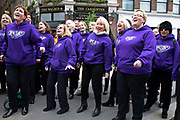 Pop song choir sing to encourage the runners at the London Marathon on 28th April 2019 in London, England, United Kingdom. The London Marathon, presently known through sponsorship as the Virgin Money London Marathon, is a long-distance running event. The event was first run in 1981 and has been held in the spring of every year since. The race is mainly known for ebing a public race where ordinary people can challenge themsleves while raising great amounts of money for various charities.
