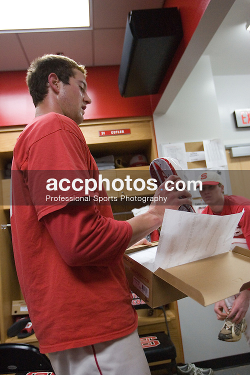 03 February 2007: North Carolina State Wolfpack RHP Andrew Brackman (40) examines new shoes in size 15 that had to be special ordered just for him, in the locker room after finishing a scrimmage where he pitched at Doak Field in Raleigh, NC.