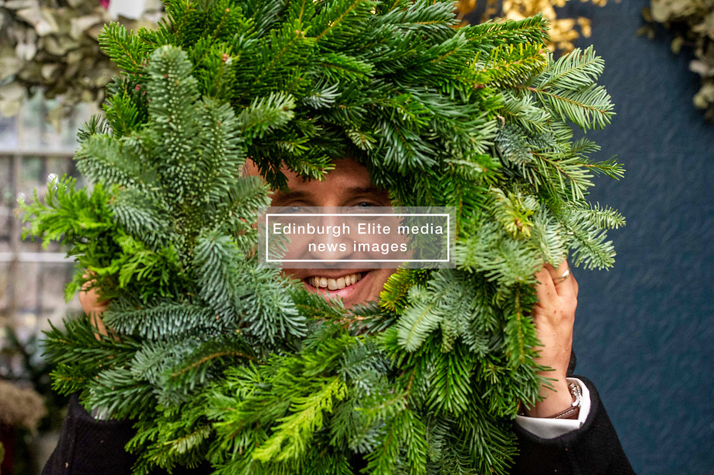 Pictured: Alex Cole-Hamilton<br /><br />Scottish Liberal Democrat Campaign Chair Alex Cole-Hamilton  was shwpon how to make Christmas wreaths by Elena Wilson while on the campaign trail at Rose & Ammi Florist in Edinburgh today.<br /><br />Ger Harley   EEm 10 December 2019