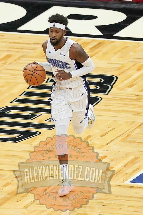 ORLANDO, FL - FEBRUARY 17:   Terrence Ross #31 of the Orlando Magic dribbles the ball against the New York Knicks at Amway Center on February 17, 2021 in Orlando, Florida. NOTE TO USER: User expressly acknowledges and agrees that, by downloading and or using this photograph, User is consenting to the terms and conditions of the Getty Images License Agreement. (Photo by Alex Menendez/Getty Images)*** Local Caption *** Terrence Ross
