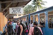 Passengers on platform at Galle railway station, Sri Lanka, Asia