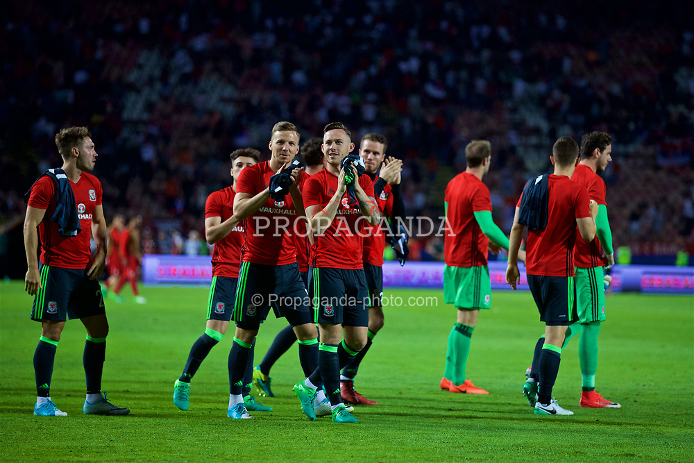 BELGRADE, SERBIA - Sunday, June 11, 2017: Wales' Lee Evans and Gethin Jones after the 1-1 draw with Serbia during the 2018 FIFA World Cup Qualifying Group D match between Wales and Serbia at the Red Star Stadium. (Pic by David Rawcliffe/Propaganda)