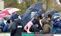 BLOEMENDAAL - Hockey - Bloemendaal-Oranje Rood 3-2.   regenbui, regen, paraplu, adidas,  COPYRIGHT KOEN SUYK