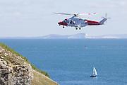 Whisky Bravo coastguard helicopter at Durlston Head. Dorset, UK.