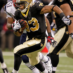 2009 November 30:  New Orleans Saints running back Pierre Thomas (23) runs with the ball during a 38-17 win by the New Orleans Saints over the New England Patriots at the Louisiana Superdome in New Orleans, Louisiana.