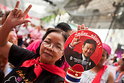 "May 12 - BANGKOK, THAILAND: A Red Shirt protester holds up a photo of exiled former Prime Minister Thaksin Shinawatra during the Red Shirt protest Wednesday. The Thai government said Wednesday that time has run out for ""Red Shirt"" protesters in Ratchaprasong and Sala Daeng intersections in Bangkok and that a crackdown could come at any time. As news of the anticipated crackdown spread, Red Shirt protesters continued with an almost festive mood at their main stage but many of the sleeping areas around the protest site appeared to be empty. No official estimates on crowd size are available.  Photo by Jack Kurtz"